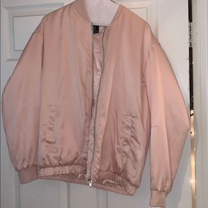 Pink fluffy jacket.